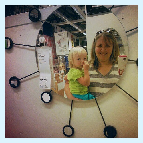 Entertaining a bored, overtired E at IKEA with mirror photos.