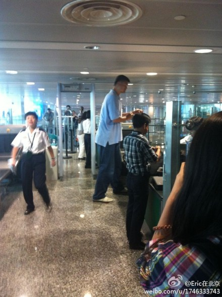 September 28th, 2012 - Yao Ming goes through security at the Perth airport as he returns to China