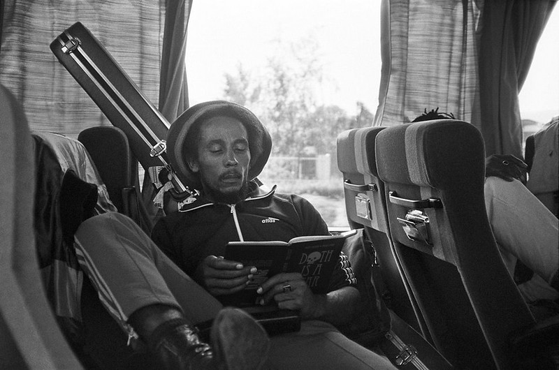 Bob Marley jamming with his favorite book