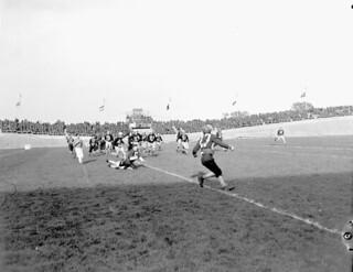 Football game between the 4th Canadian Armoured Division Atoms and... / Une partie de football entre les Atoms de la 4e division blindée du Canada et...