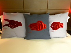 art(1.0), textile(1.0), furniture(1.0), red(1.0), bed sheet(1.0), pillow(1.0), throw pillow(1.0), cushion(1.0),