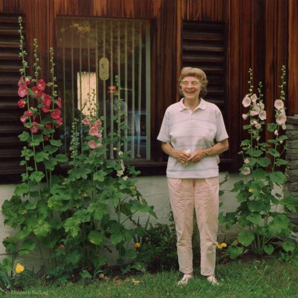 Grandma with hollyhocks, by Elizabeth Ruffing