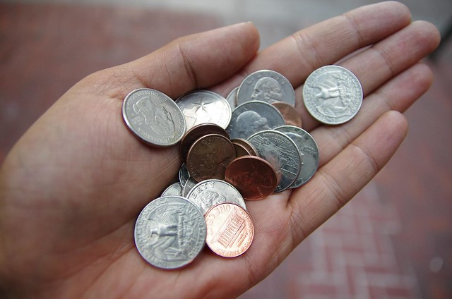 Holding American Coins in hand