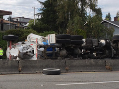 Before/After shots of overturned cement truck