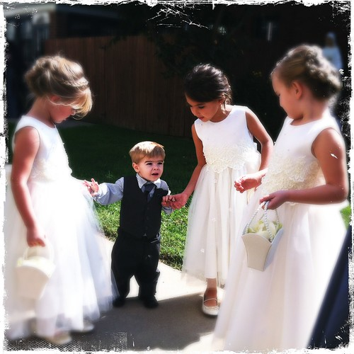 Liam had a small meltdown just before the wedding started, so he didn't get to walk. But he was quite the ladies man.