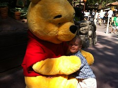 Hugging Pooh.