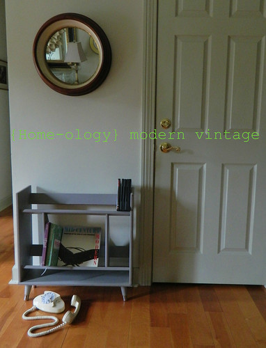 mid century bookstand/media center via homeologymodernvintage.com