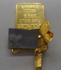 Tungsten-filled gold bar