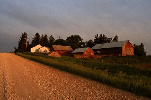 film barn rural sunrise nikon midwest fuji farm shed roadtrip iowa ia dirtroad nikkor monticello nikonf smalltown countryroad fujisuperia200 c41 nikkorhauto28mmf35
