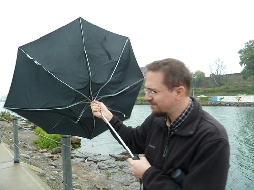 Paul stuggling with a cranky umbrella