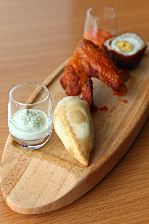 Amuse Bouche - Trilogy of Spicy Oxtail Empanadas, Scoth Eggs & Peri Peri Chicken Wings