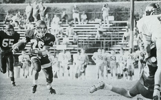 John Parker '89 carrying the ball during the 1988 game against Whittier