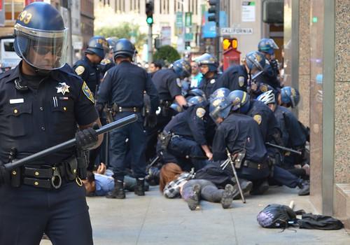 Police arresting #fuckColumbus on Battery btwn California & Sacramento