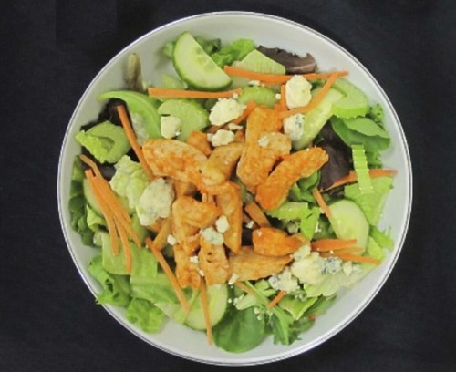 Mesclun salad greens with Buffalo chicken