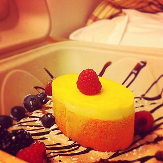 Pineapple mousse/coconut cake dessert to enjoy in bed. They decorated the takeout box!