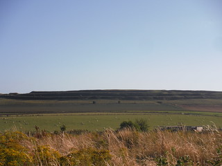 Maiden Castle Iron Age Hillfort, in the evening sun