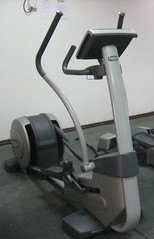 automotive exterior(0.0), arm(0.0), sport venue(0.0), indoor rower(0.0), barbell(0.0), leg extension(0.0), exercise machine(1.0), exercise equipment(1.0), room(1.0), gym(1.0),
