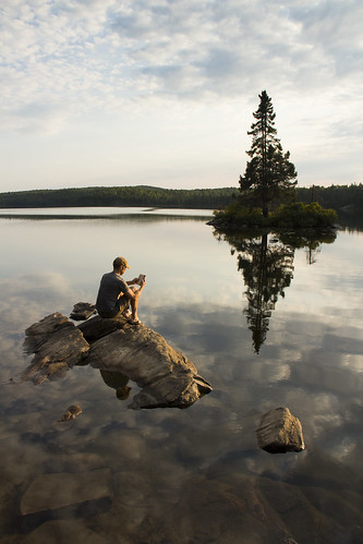 Floating on the smooth surface of Tom Thomson Lake