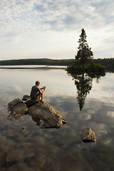 Floating on the smooth surface of Tom Thomson Lake by Scott Robertson, Montreal