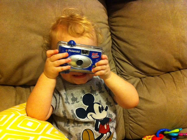 "George loves shouting ""CHEESE!"" when he holds this old camera up to his face."