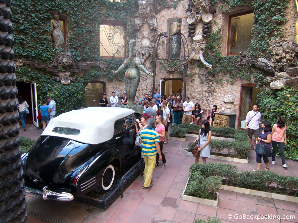 Down below, a Cadillac draws visitor's attention in the inner courtyard
