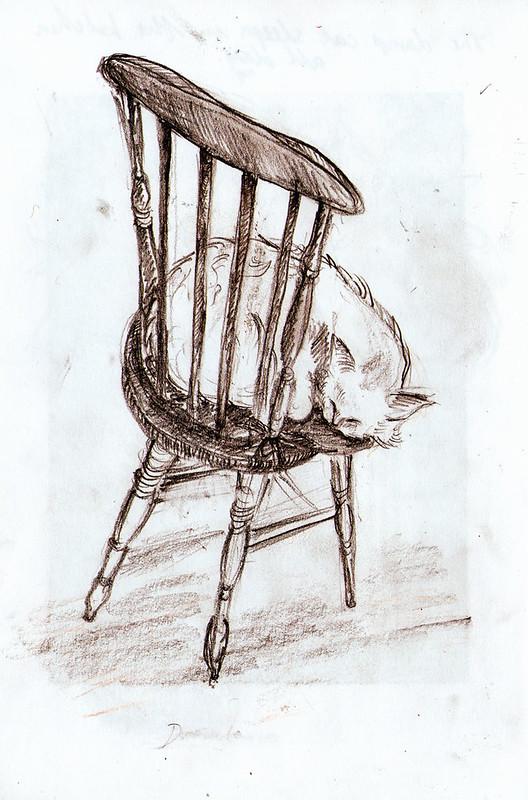 Dracula sleeps on a chair