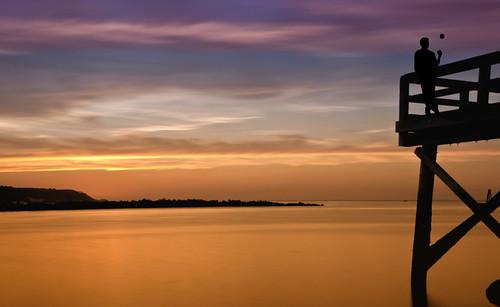 longexposure sunset red sky orange man beach nature colors silhouette clouds ball bay harbor pier dock nikon flickr tripod longisland toss boardwalk lowtide 2012 lightroom hss cedarbeach perfecttiming 18200mm d90 wowography nd110 107866 longislandphoto mygearandme mygearandmepremium wowographycom