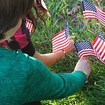 Placing flags by Columbia Independent School