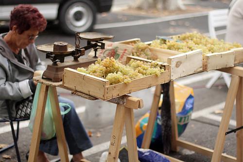 grape seller at market