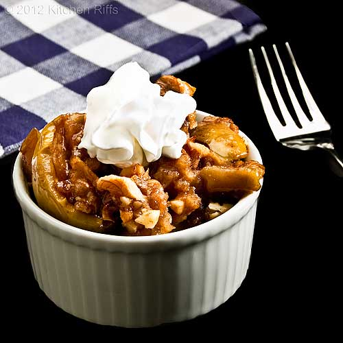 Walnut Apple Crisp with Whipped Cream Garnish in Bowl with Napkin and Fork