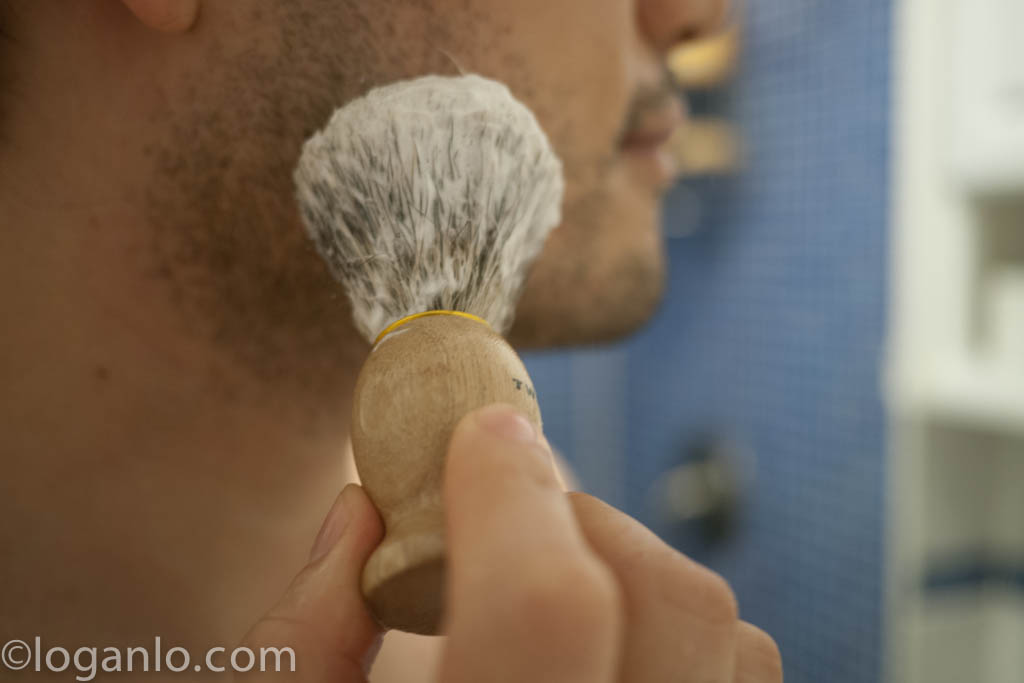 Using a shave brush to lather up the face