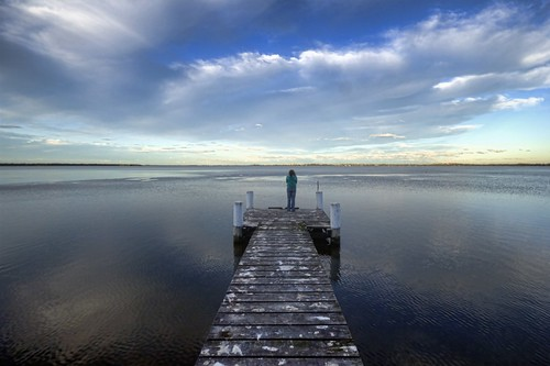 very patient photographers wife freezing on the end of a jetty waiting for said photographer to capture his sunset