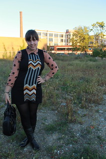 Polka dots and chevron outfit: sheer polka dot blouse, Missoni for Target sweater dress, black opaque tights, Quilted leather boots, studded bottom bag