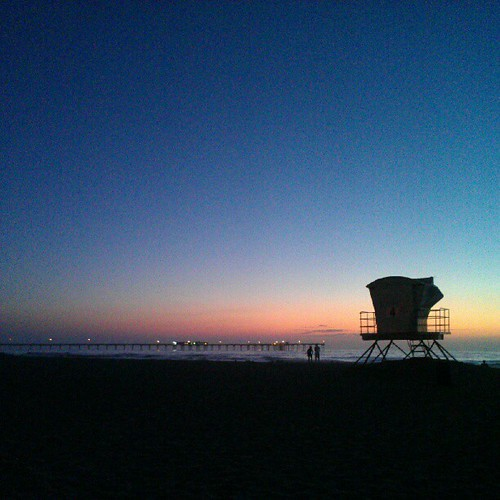 sunset and a lifeguard tower