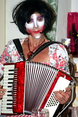 accordion(1.0), red(1.0), folk instrument(1.0), garmon(1.0), wind instrument(1.0),