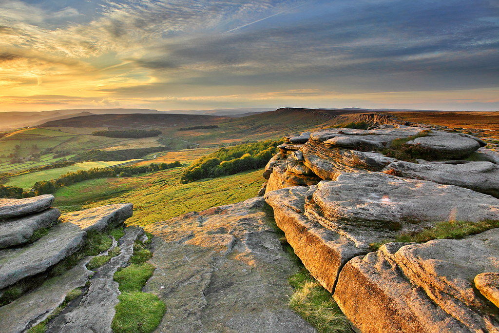 sunset light on stanage edge in the peak district, beautiful landscape photograph