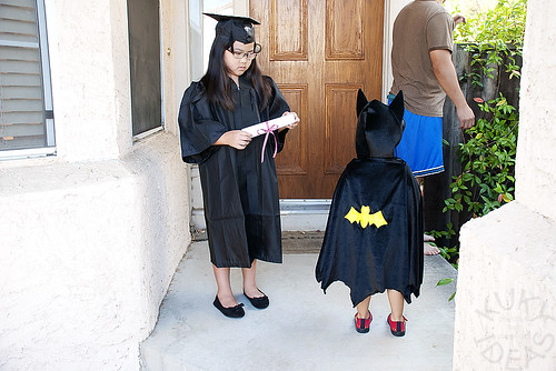 Batman wanted in on the graduation pictures