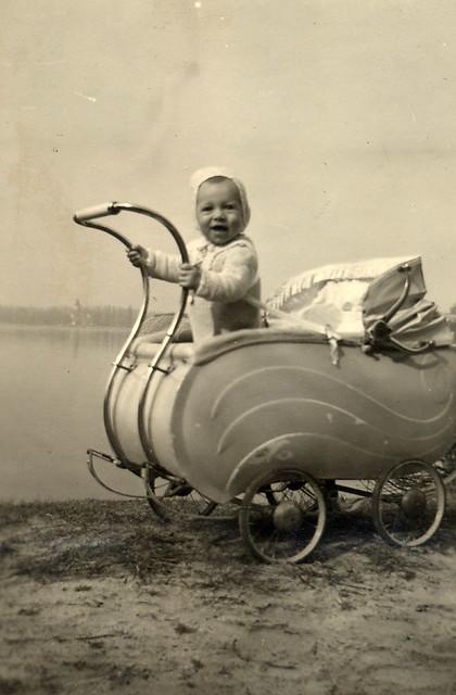 Child in a distinctive pram
