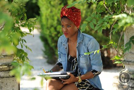 Sonjia sketching under a tree