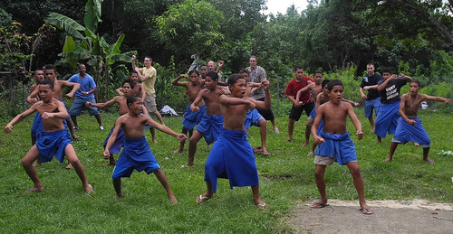 Coast guard learning the Manu Samoa war dance from the warriors of Samatau Primary school.