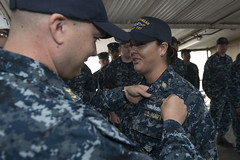 Chief Culinary Specialist Dominique Saavedra, assigned to USS Michigan (SSGN 727)(Blue), is pinned with her enlisted submarine qualification. (U.S. Navy/MCC Kenneth G. Takada)