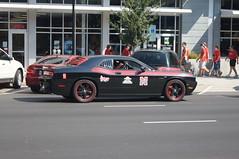 auto racing(0.0), stock car racing(0.0), race track(0.0), race car(1.0), automobile(1.0), racing(1.0), wheel(1.0), vehicle(1.0), performance car(1.0), automotive design(1.0), motorsport(1.0), dodge challenger(1.0), classic car(1.0), land vehicle(1.0), luxury vehicle(1.0), muscle car(1.0), supercar(1.0), sports car(1.0),