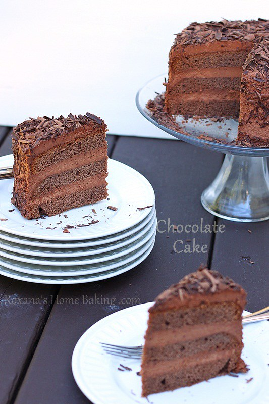 The perfect Triple Chocolate Layer Cake - rich double chocolate cake with a creamy chocolate frosting and chocolate shavings. Recipe from Roxanashomebaking.com