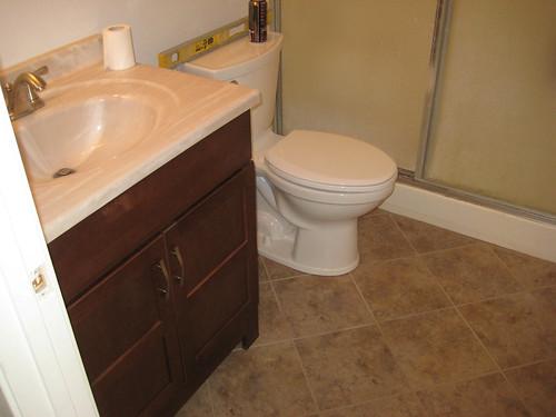 New vanity, toilet & tile in bath