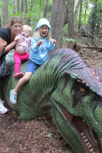 Tried to get a picture of both girls on the dinosaur, Lucy was not having it.