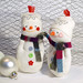 A pair of Sock Snowmen with sparkly hats