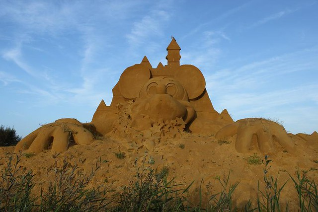 big Mickey Mouse made of sand