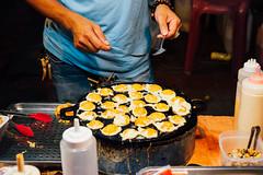Thai man cook quail eggs