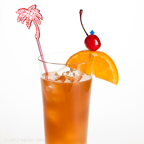 Bermuda Rum Swizzle with Swizzle Stick, Orange Slice, and Maraschino Cherry Garnish, White Background