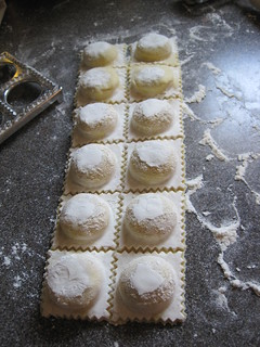 5. Remove the dough carefully from around the edges. Then, slowly turn it upside-down and gently push out the pasta with your fingers. Keep it really close to the counter. Then cut them apart, using a pasta wheel: